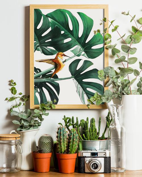 Tableau colibri sur plante verte pour une décoration murale tendance